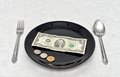 Plate of money in a on marble dining table Stock Photos