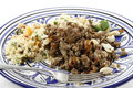 Plate of moroccan style mince and couscous minced beef cooked with onion spices served with garnished with toasted nuts Royalty Free Stock Photo
