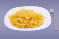 Plate with noodles Stock Image