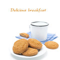 Plate of oatmeal cookies and mug of milk isolated on white Royalty Free Stock Image