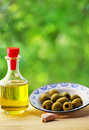 Plate of olives and oliveoil Royalty Free Stock Photo