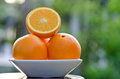 Plate of orange fresh fruit serve in garden Stock Photo
