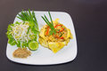 Plate of pad thai or phat thai in omelette Stock Photo