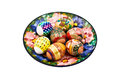 Plate painted flowers lay eggs pasalnye colored shrink wrapping Royalty Free Stock Photos