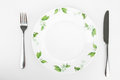 Plate with a picture of flowers, knife and fork Royalty Free Stock Photo