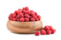 Plate with raspberries bamboo full of ripe red on a white background Stock Photography