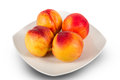Plate of ripe nectarines delicious juicy on white Royalty Free Stock Image