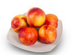 Plate of ripe nectarines delicious juicy on white Royalty Free Stock Photography