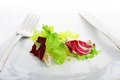 Plate with salad over white table Stock Image