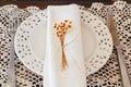 Plate serviette fork knife dried flowers crochet doily Royalty Free Stock Photo