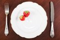 Plate with silverware and strawberries Royalty Free Stock Image