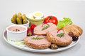 Plate with slices of bread with home made pate decorated vegetables Stock Images