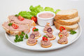 Plate with slices of bread with home made pate decorated vegetables Stock Photo