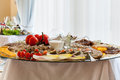 Plate with snacks a glass cold reception table Stock Photos