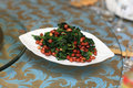 Plate of spinach salad with peanuts in a chinese restaurant Royalty Free Stock Photos