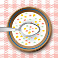 Plate with spoon and flakes Stock Photography