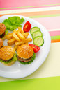 Plate with tasty  burgers Stock Photo