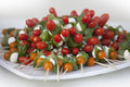 Plate of Tomato Mozzarella Skewers Stock Photos