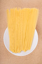 Plate with uncooked pasta dried on the table Stock Images