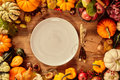Plate and utensils with tag surrounded by gourds Royalty Free Stock Photo