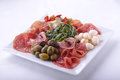 Plate various salami olives mozzarella salad Royalty Free Stock Image