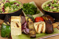 Plate of vegan grilled vegetables with tofu a closeup image a white dinner different healthy there are mushroom gravy red pepper Stock Photography