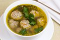 Plate of vegetable soup with meatballs a on a white Stock Image