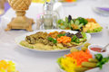 Plate with vegetables on festive table Royalty Free Stock Images