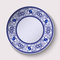 Plate with a wide floral design border in the style of Gzhel with an empty space in the center. Royalty Free Stock Photo