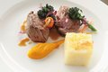 Plated meat meal gourmet beef lamb steak Royalty Free Stock Images
