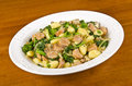 Plateful gnocchi rapini italian sausages crimini mushrooms onion Royalty Free Stock Photography