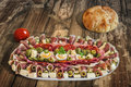 Plateful of Serbian Appetizer Meze with Pita Bread and Tomato on Royalty Free Stock Photo
