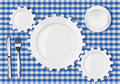Plates gears work concept. Dinner dishes over tablecloth.