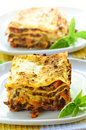 Plates of lasagna Stock Photos