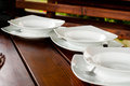 Plates on table three a waiting for food serving Stock Photography