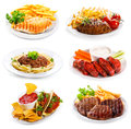 Plates of various meat and chicken on white background Stock Image
