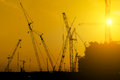 Platform oil rig fabrication site silhouette of construction activities Stock Photo