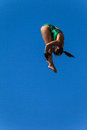 Platform pool diving girl competition aquatic unidentified unrecognizable with courage tenacity into somersaults spins and twists Stock Image