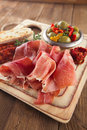 Platter of serrano jamon cured meat ciabatta chorizo and olive olives Royalty Free Stock Images