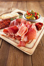 Platter of serrano jamon cured meat ciabatta chorizo and olives Stock Photography