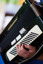 Play the accordion hand leads to keys Stock Photography