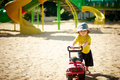 Play with car guy driving his on the sand in the playground Royalty Free Stock Photography