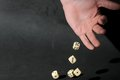 Play dice an hand on a dark background Royalty Free Stock Photography