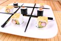 Play tic tac toe with sushi and black chopsticks close up Royalty Free Stock Images