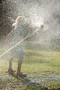 Play with water jets Royalty Free Stock Photo