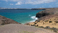 Playa de papagayo beach famous for its blue water lanzarote island Stock Photo