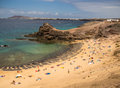 Playa del papagayo lanzarote canary islands holidaymakers on the golden sands of papagayao beach in Stock Photography