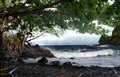 Playa hawaiana sombría Foto de archivo libre de regalías