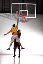 Player defect jump for block score in basketball game Royalty Free Stock Photography