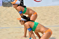 Player of female beach volleyball in match shown as feature and environment the sport or team ready for match Royalty Free Stock Image